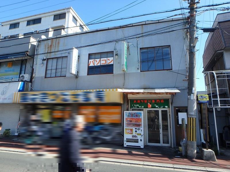外壁塗装前の店舗ビル正面