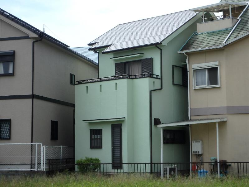 緑色の住宅